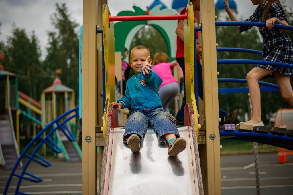 smiling-boy-playing-on-the-playground_t20_GgmPae