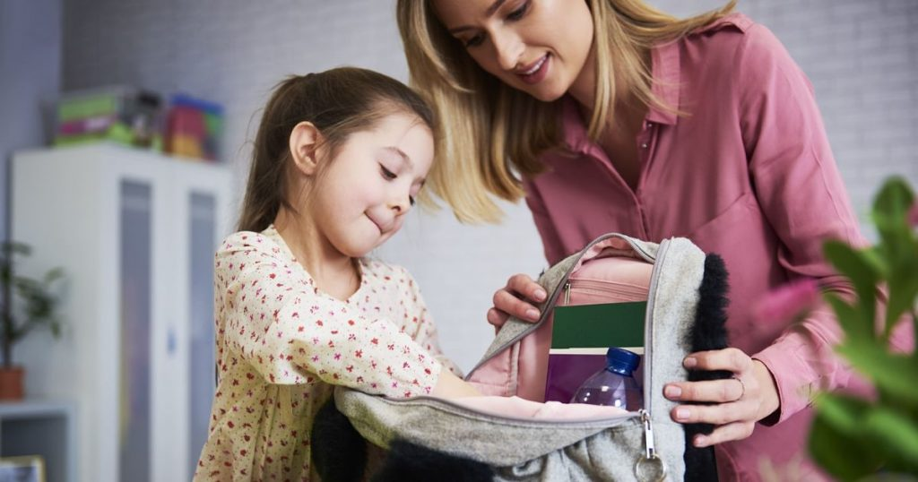 young-mum-and-daughter-packing-backpack-for-the-Y642MG2-min_opt
