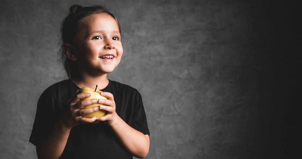 portrait-of-a-happiness-little-girl-eating-a-green-655BLGG-min_opt